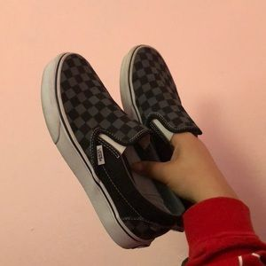 Checkered grey and black vans